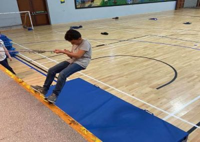 Clonmany Community Centre child practising ab sailing at Activity camp